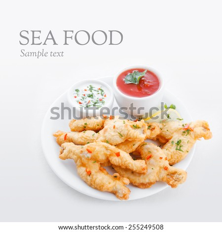 Deep fried frog legs with sauces - stock photo
