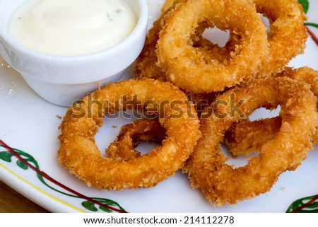 Deep fried onion ring with sauce - stock photo
