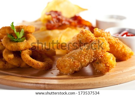 Deep Fried Onion Rings, Cheese Balls, Potato Chips, Bacon Chips and Tar-tar Sauce - stock photo