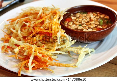 Deep fried papaya and carrot serve with Thai style sauce. Tempura - stock photo