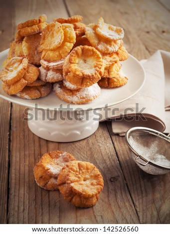 Deep-fried pastry on wooden table - stock photo