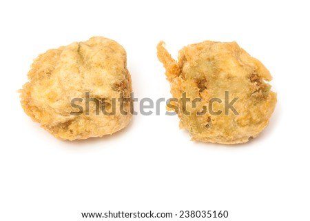 Deep fried Pea fritters or balls fresh from the fish and chip shop. - stock photo