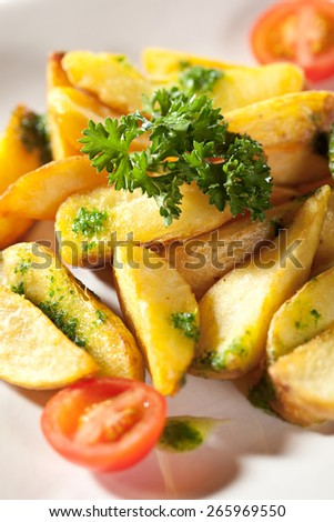 Deep Fried Potato Slice Garnished with Cherry Tomato and Parsley - stock photo
