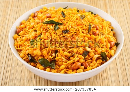 Deep fried salty dish - chivda or mixture made of gram flour and mixed with dry fruits. - stock photo