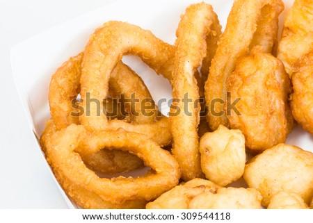 Deep fried seafood take away consisting of calamari,squid balls and prawn nuggets - stock photo