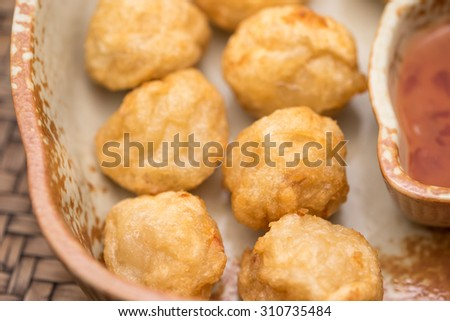 Deep fried shrimp balls with hot chili sauce in ceramic bowl for appetizer background