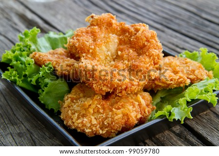 deep fried shrimp meat ball on wooden table - stock photo