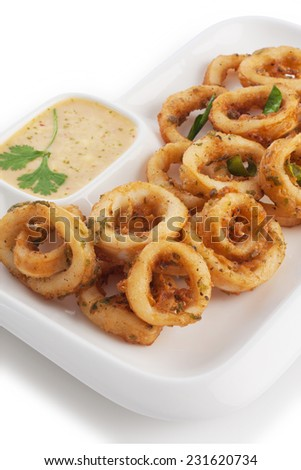 Deep fried squid & soft batter serve with tartar sauce, isolated on white. - stock photo