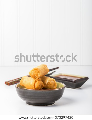 Deep fried vegetarian egg rolls with dipping sauce. - stock photo