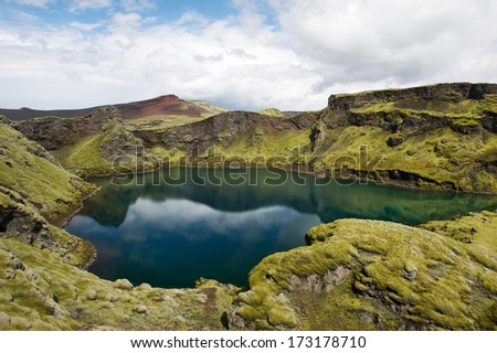 Deep lake hidden in eruption crater covered with moss at Lakagigar area, Iceland - stock photo