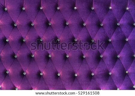 deep Purple velvet texture of sofa closeup shot - luxury violet velvet texture with diamond jewelry background. Vintage retro chair made