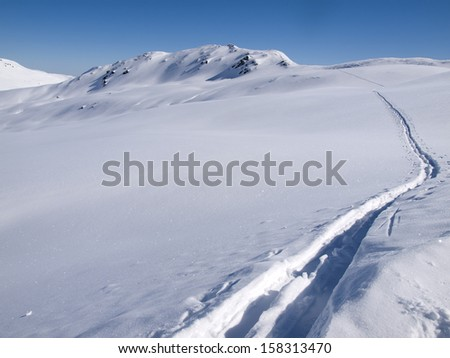 Deep skiing tracks in the snow on the alps in Austria