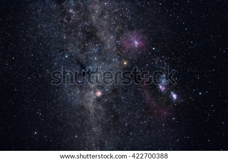 Deep space image containing constellations Orion, Monoceros, Gemini and many bright nebulae and star clusters - stock photo