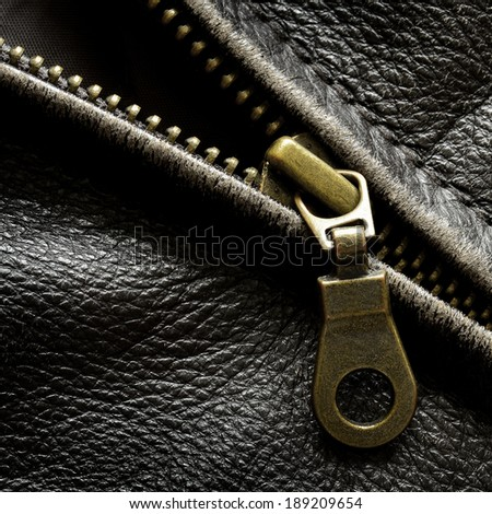 Deep textured leather jacket with brass zipper - stock photo