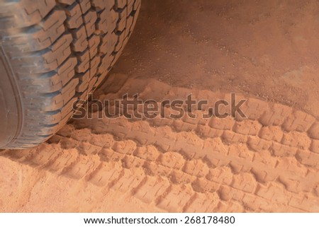 Deep trace of wheels on a sandy road - stock photo