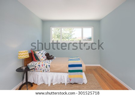 Deep Turquoise Blue bedroom with colorful decoration. - stock photo
