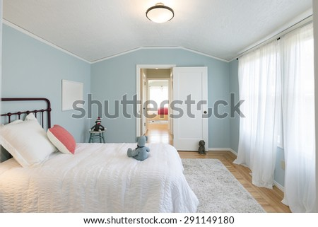 Deep Turquoise Blue Children bedroom / kids room / teen room with colorful decoration. - stock photo