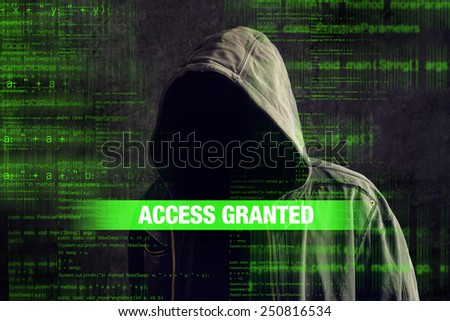 Deep web concept, access granted to faceless hooded anonymous computer hacker with programming code from monitor - stock photo