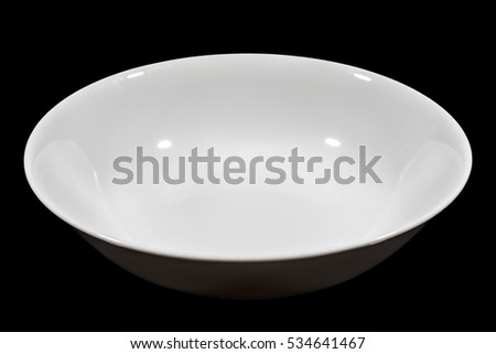 Deep white small soup plate on black background from side