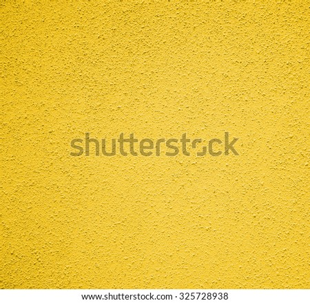 deep yellow concrete on the wall , texture background