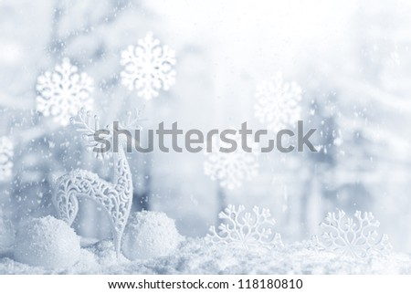 Deer and Christmas ball in snowfall,Christmas background. - stock photo