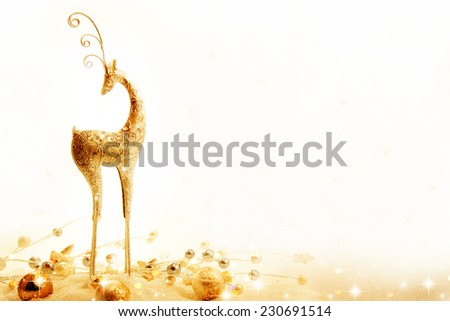 Deer and Christmas decoration in snow. - stock photo