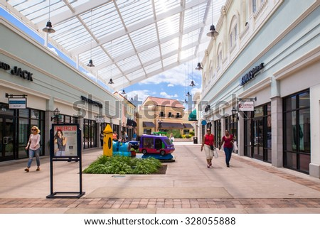 DEER PARK, NY - JULY 22, 2015: View of Tanger Factory Outlet outdoor shopping mall on Long Island, NY  - stock photo