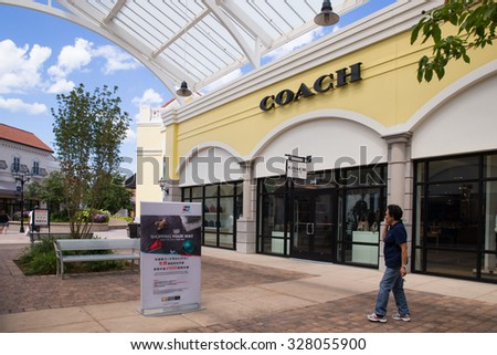 DEER PARK, NY - JULY 22, 2015: View of Tanger Factory Outlet outdoor shopping mall on Long Island, NY near the Coach Store - stock photo