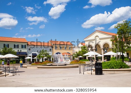 DEER PARK, NY - JULY 22, 2015: View of Tanger Factory Outlet outdoor shopping mall on Long Island, NY with the fountain in view - stock photo