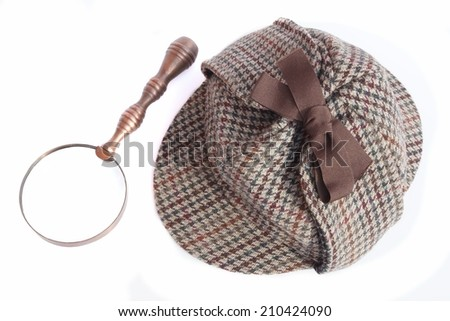 Deerhunter or Sherlock Holmes hat and vintage magnifying glass Isolated on white - stock photo