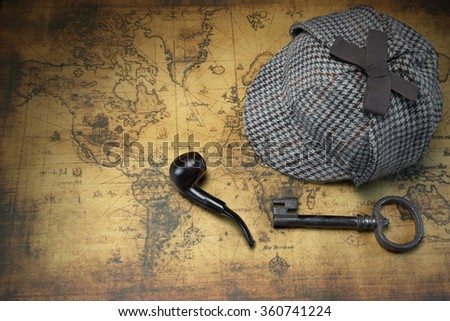 Deerstalker Sherlock Holmes Hat, Vintage Key And Smoking Pipe On The Old World Map Background. Overhead View.  Investigation Concept. - stock photo