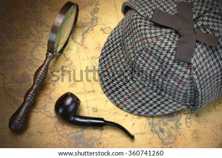 Deerstalker Sherlock Holmes Hat, Vintage Magnifier And Smoking Pipe On The Old World Map Background. Overhead View.  Investigation Concept. - stock photo