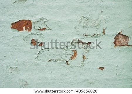 Defective paint on a brick wall - stock photo