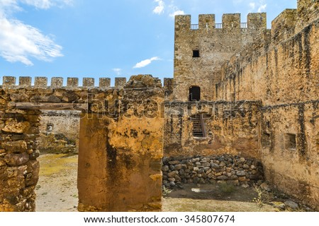 Defence tower and battlements of the old Venetian fortress Frangokastello.Inner yard.Crete island.District of Rethymno. Greece.Europe. - stock photo