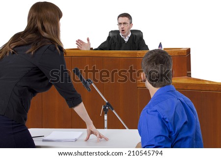 defendant with lawyer speaking to a judge in the courtroom - stock photo