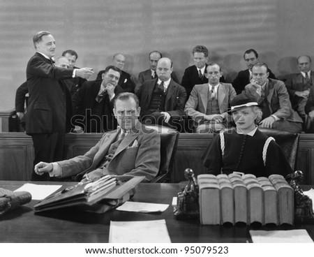 Defendants with lawyer and jury - stock photo