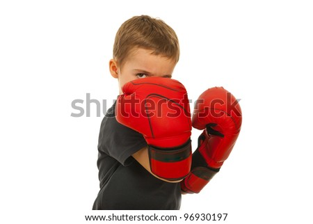 Defending little boy with boxing gloves isolated on white background