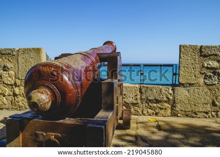 Defense, Spanish cannon pointing out to sea fortress - stock photo
