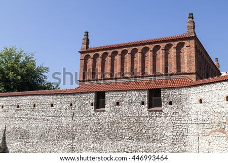 Defensive wall of old synagogue in jewish district of Krakow - Kazimierz on Szeroka street , Poland - stock photo