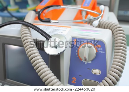 Defibrillator and stethoscope  - stock photo