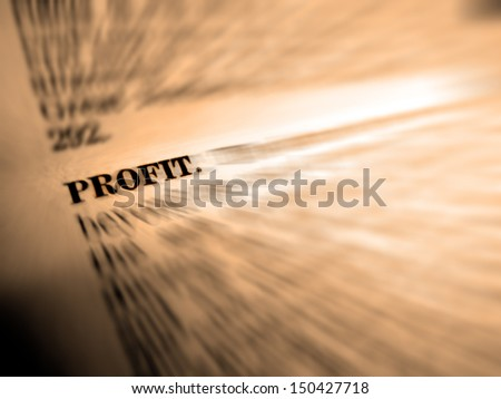 Definition of profit in dictionary book on pages with type - stock photo
