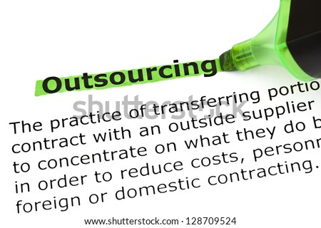 Definition of the word Outsourcing, highlighted in green with felt tip pen. - stock photo