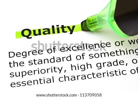 Definition of the word Quality highlighted in green with felt tip pen - stock photo