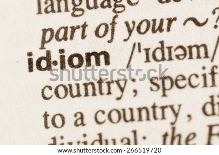 Definition of word idiom in dictionary - stock photo