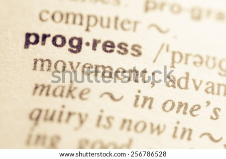Definition of word progress in dictionary - stock photo