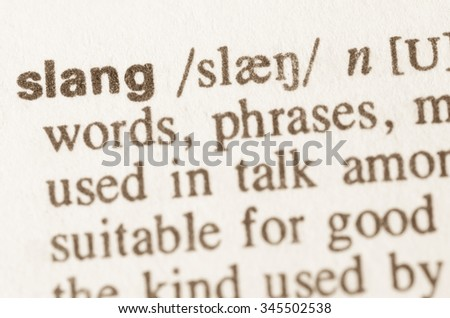 Definition of word slang in dictionary - stock photo