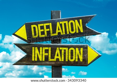 Deflation - Inflation signpost with sky background - stock photo