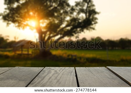 Defocus and blur image of Agriculture terrace wood and beautiful sunset meadow for background usage - stock photo