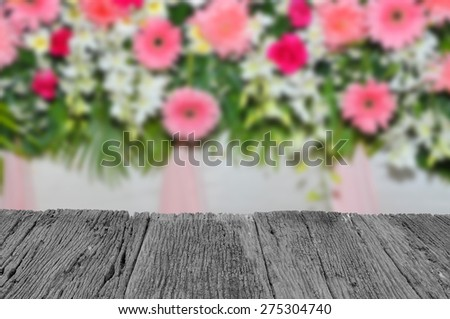 Defocus and blur image of terrace wood andPink and white backdrop flowers arrangement for background usage - stock photo