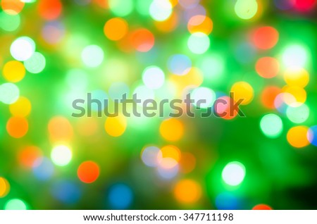 Defocused abstract bokeh light background, green, orange - stock photo
